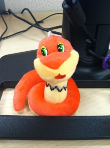 This is my new desk decoration-- a snake!  It was the best surprise ever on this Monday morning, courtesy of my coworker Maggie!