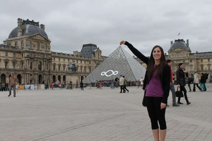 "As we were walking around the promenade in front of the Louvre, my mom asked, ""How come people keep doing that funny pose with their hands??""  She didn't get what they were doing doing haha!"