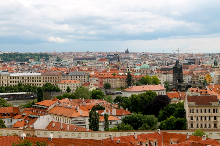 The dark tower on the right is the far end of St. Charles Bridge!